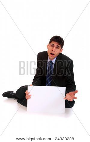 A business man sitting and begging holding an empty sign