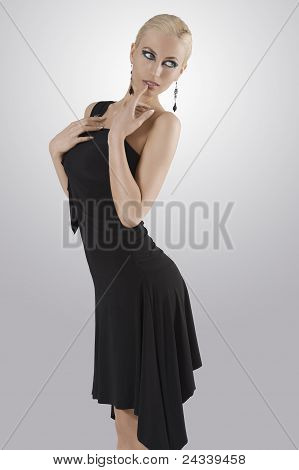 Blond Girl In Black Dress Standing With Pose