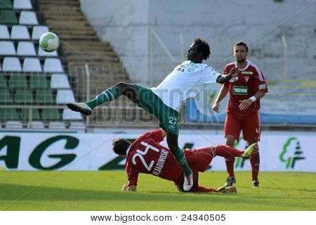 KAPOSVAR, HUNGARY - SEPTEMBER 24: Haruna Jammeh (in white) in action at a Hungarian National Championship soccer game - Kaposvar (white) vs Debrecen (red) on September 24, 2011 in Kaposvar, Hungary.