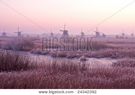 Windmills at Kinderdijk at sunset in the Netherlands in winter