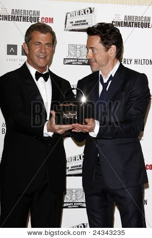LOS ANGELES - OCT 14:  Mel Gibson, Robert Downey Jr arriving at the 25th American Cinematheque Award Honoring Robert Downey Jr. at the Beverly Hilton Hotel on October 14, 2011 in Beverly Hills, CA