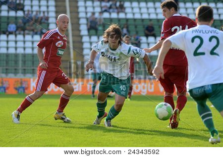 KAPOSVAR, HUNGARY - SEPTEMBER 24: Bojan Pavlovic (white 22) in action at a Hungarian National Championship soccer game - Kaposvar (white) vs Debrecen (red) on September 24, 2011 in Kaposvar, Hungary.