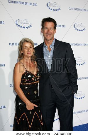 .LOS ANGELES - OCT 14:  James Denton, wife arriving at the Clinton Foundation