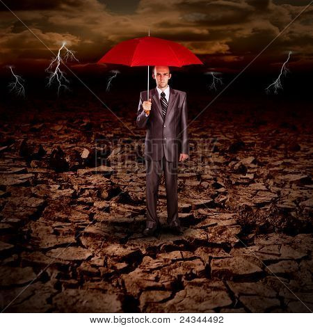 Serious Businessman With Red Umbrella