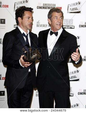 LOS ANGELES - OCT 14:  Robert Downey Jr, Mel Gibson arriving at the 25th American Cinematheque Award Honoring Robert Downey Jr. at the Beverly Hilton Hotel on October 14, 2011 in Beverly Hills, CA