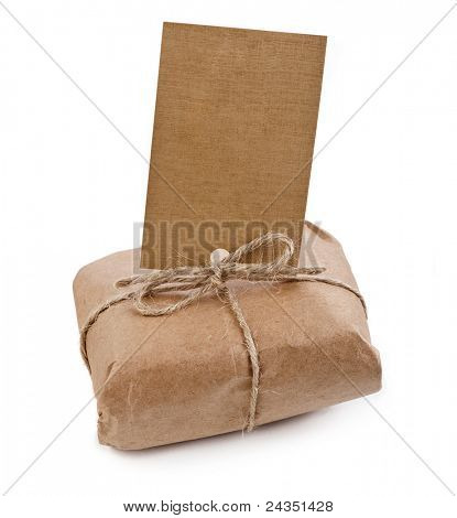 brown paper package tied with string with label, isolated on white