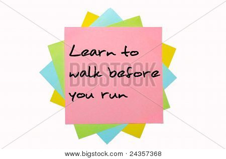 "Proverb ""learn To Walk Before You Run"" Written On Bunch Of Sticky Notes"