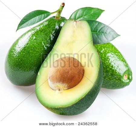 Ripe avacado with leaves on a white background.