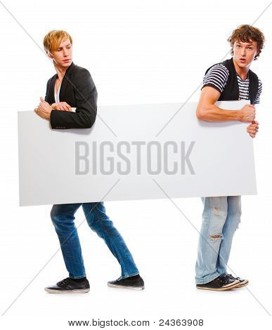 Two Teenagers Holding Blank Billboard. Isolated On White