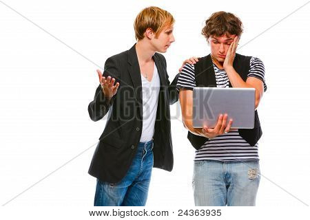 Young Man Calms His Looking In Laptop Friends. Isolated On White