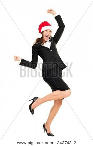 Christmas business woman wearing santa hat dancing happy and excited standing in full body. Beautiful smiling cheerful mixed race Asian Caucasian female businesswoman isolated on white background.