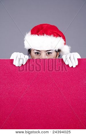 Woman With Christmas Hat And A Blank Sign