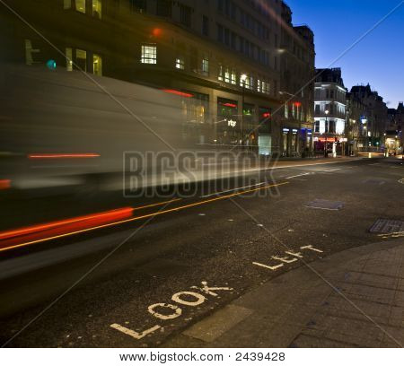 Look Left Sign With Traffic Motion Blur