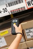 picture of barcode  - hand is holding a handheld barcode scanner - JPG