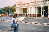 Young Asian Woman Traveler With Backpack And Hat Standing And Looking For Search Way For Travel At T poster