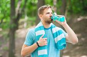 Man With Athletic Appearance Holds Bottle With Water. Sport And Healthy Lifestyle Concept. Athlete D poster