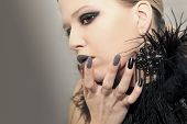 Glamorous Matte Black Gray Makeup, And Manicures On A Sharply Oval-shaped Nails With Feathers Of A M poster