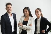 Millennial Smiling Multi-ethnic Professional Office Employees Looking At Camera, Asian And Caucasian poster