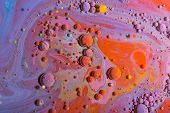 Abstract colorful background. Ink bubbles in the water. Fantastic ink in the water poster