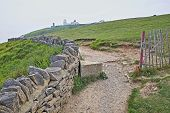 Coastal Footpath Leading To Anvil Point Lighthouse At Durlston Head Near Swanage, Isle Of Purbeck, D poster