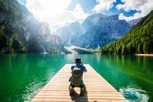 Traveler Taking Photo Of Lake Braies In Italy. poster