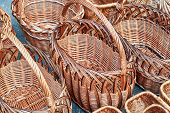 Several Rows Of Wicker Baskets. Baskets Are Woven From Vines. The Weaving Pattern And Design. Basket poster