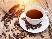 Hot Coffee Cup With Coffee Bean On Wooden Table. Coffee Background For Cafe Or Coffee Shop poster