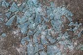Lying On The Ground A Lot Of Sharp Fragments Of Broken Glass. Glass Fragments Of Different Shapes An poster