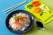 Cellophane Noodles On A Plate On A Wooden Table With Vegetables Salad Cooking poster