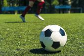 Out Of Focus Shot Of Soccer Balls And Legs Of Soccer Players During A Soccer Training Session On Gre poster