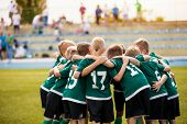 Young Football Soccer Players In Sportswear. Young Sports Team With Football Coach. Pep Talk With Co poster
