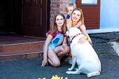 Family With A Large Labrador Retriever In The Background Of A House On The Lawn. Mother, Daughter An poster