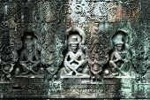 stock photo of asura  - The sculpted statues of mandapa Siem Reap Cambodia - JPG