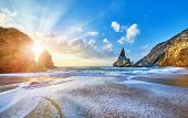 Portugal Ursa Beach at atlantic coast of Atlantic Ocean with rocks and sunset sun waves and foam at  poster