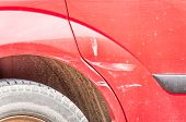 Damaged Car. Red Scratched Car With Damaged Paint In Crash Accident Or Parking Lot And Dented Metal  poster