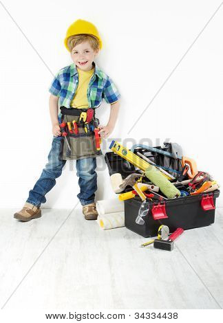 Little Boy Handyman In Hard Hat And Tool Belt Next To Construction Toolbox Full Of Tools