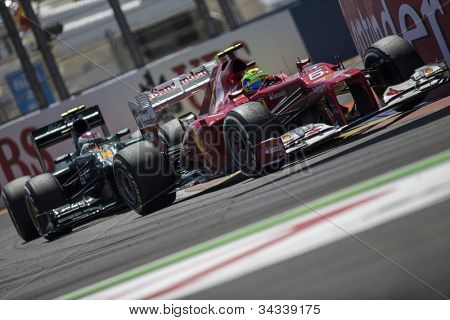 VALENCIA, SPAIN - JUNE 24: First Place Felipe Massa and Pastor Maldonado in the Formula 1 Grand Prix of Europe, Valencia Street Circuit. Spain on June 24, 2012