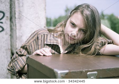 Girl Standing Near The Suitcase