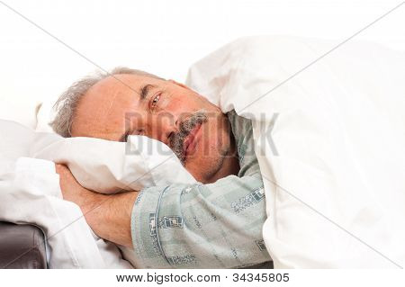 Elderly Man Laying In Bed
