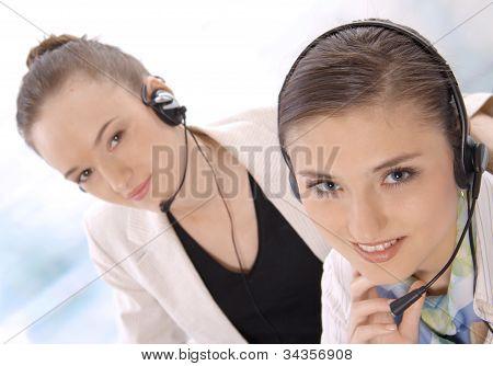 Closeup portrait of successful female customer service representatives