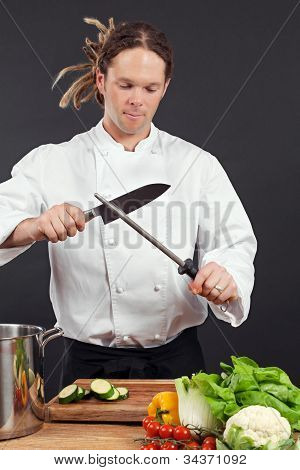 Chef Sharpening His Knife