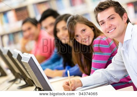 Online education - group of students studying with computers