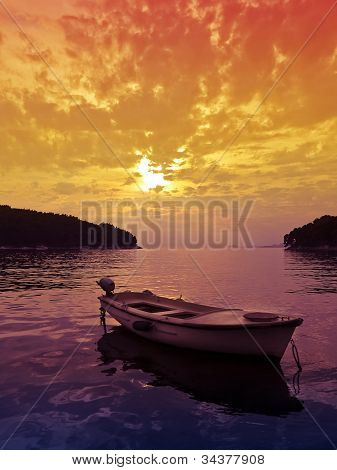 Sunset Scene With Small Boat
