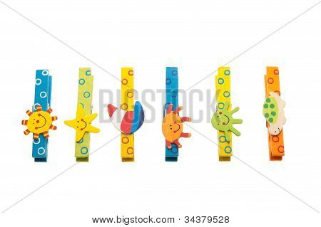 Colorful Clothespins With Wooden Figures Lying In A Row