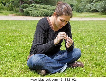 young woman plucking the daisy