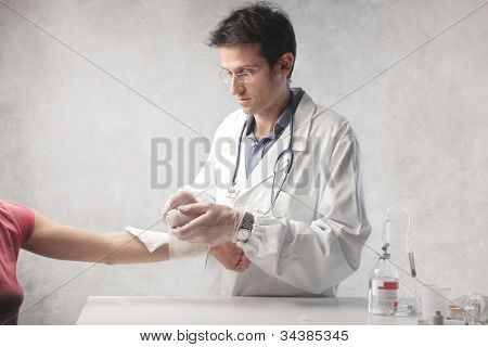 Doctor medicating a woman's arm