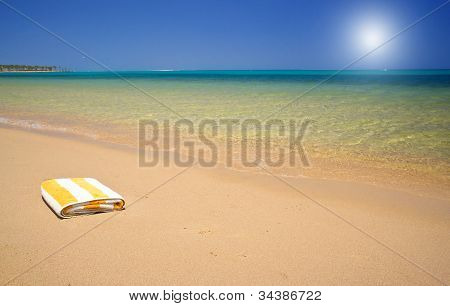 Turquoise Sea And Towel.