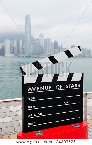 HONG KONG, CHINA - APR 17: Statue and skyline in Avenue of Stars on April 17, 2012 in Hong Kong, China. The promenade honors celebrities of the Hong Kong film industry as the famous city attraction.