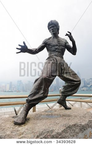 HONG KONG, CHINA - APR 17: Bruce Lee Statue in Avenue of Stars on April 17, 2012 in Hong Kong, China. The promenade honors celebrities of the Hong Kong film industry as the famous city attraction.