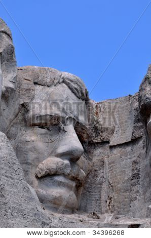 Closeup of former U.S. president Theodore Roosevelt at the Mount Rushmore National Memorial in South Dakota